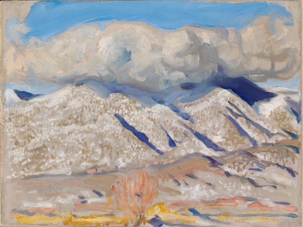 Taos-vuoret pilvien peitossa