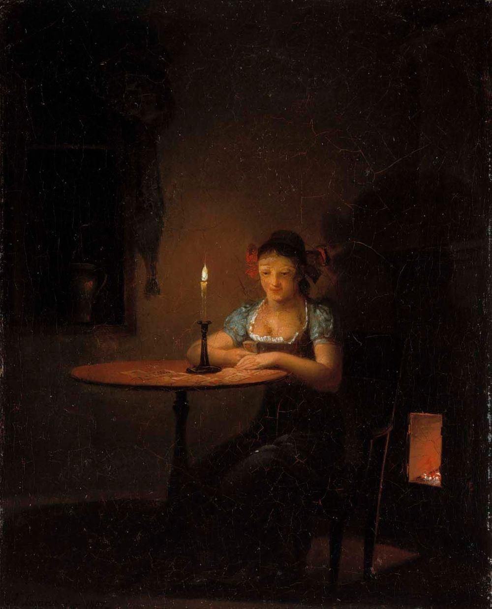 Nuori nainen pelaamassa pasianssia