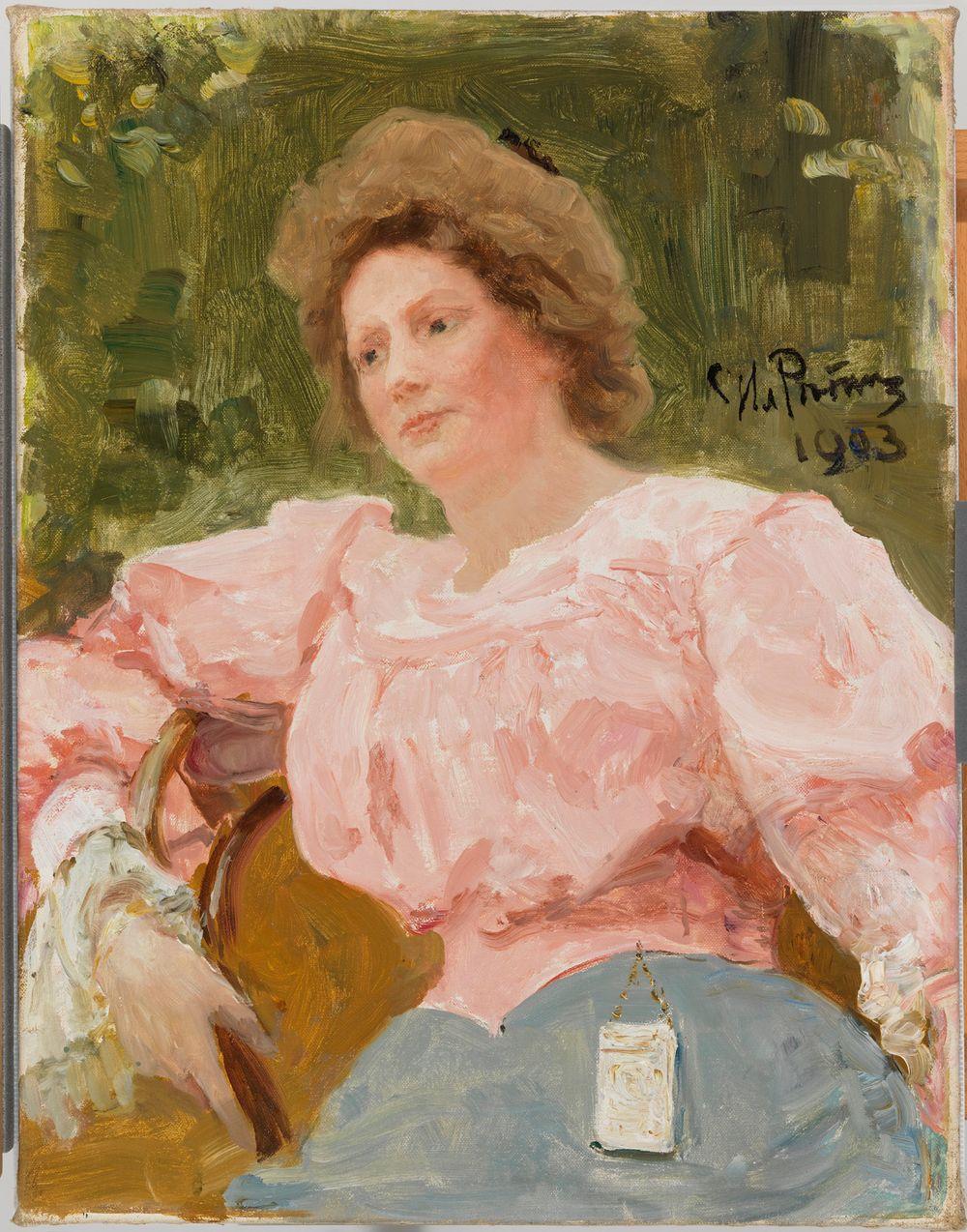 Ung kvinna i rosa dräkt