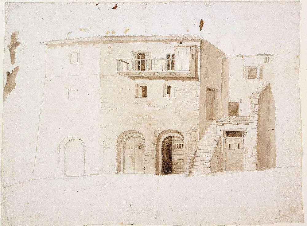 AIHE Italiasta: Kivitalo, keskellä kaksi porttia ja portaat
