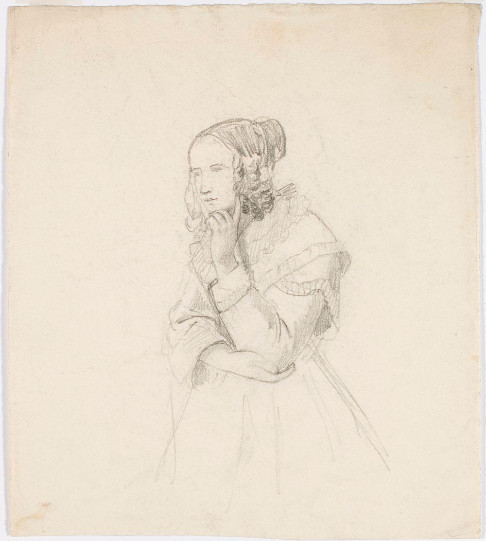 Nainen, joka nojaa leukaansa vasempaan käteen