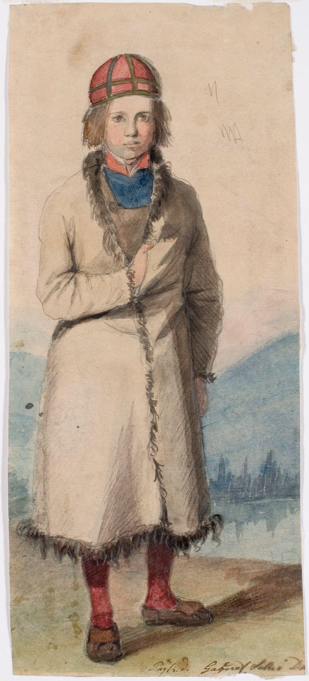 Seisova poika taalalaisturkissa, taustalla maisema