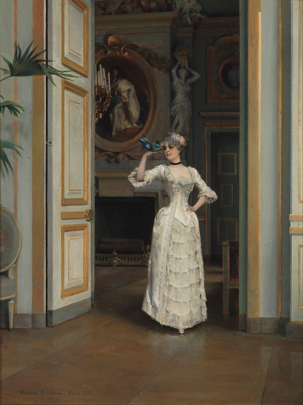 Nainen lintu kädessä Maison Laffitten linnassa