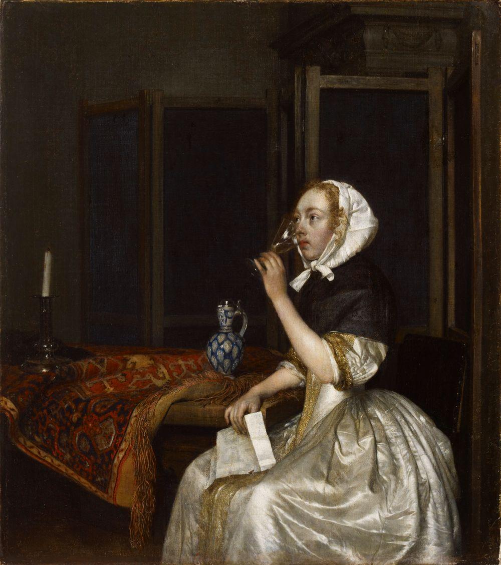 Viiniä juova nainen kirje kädessään