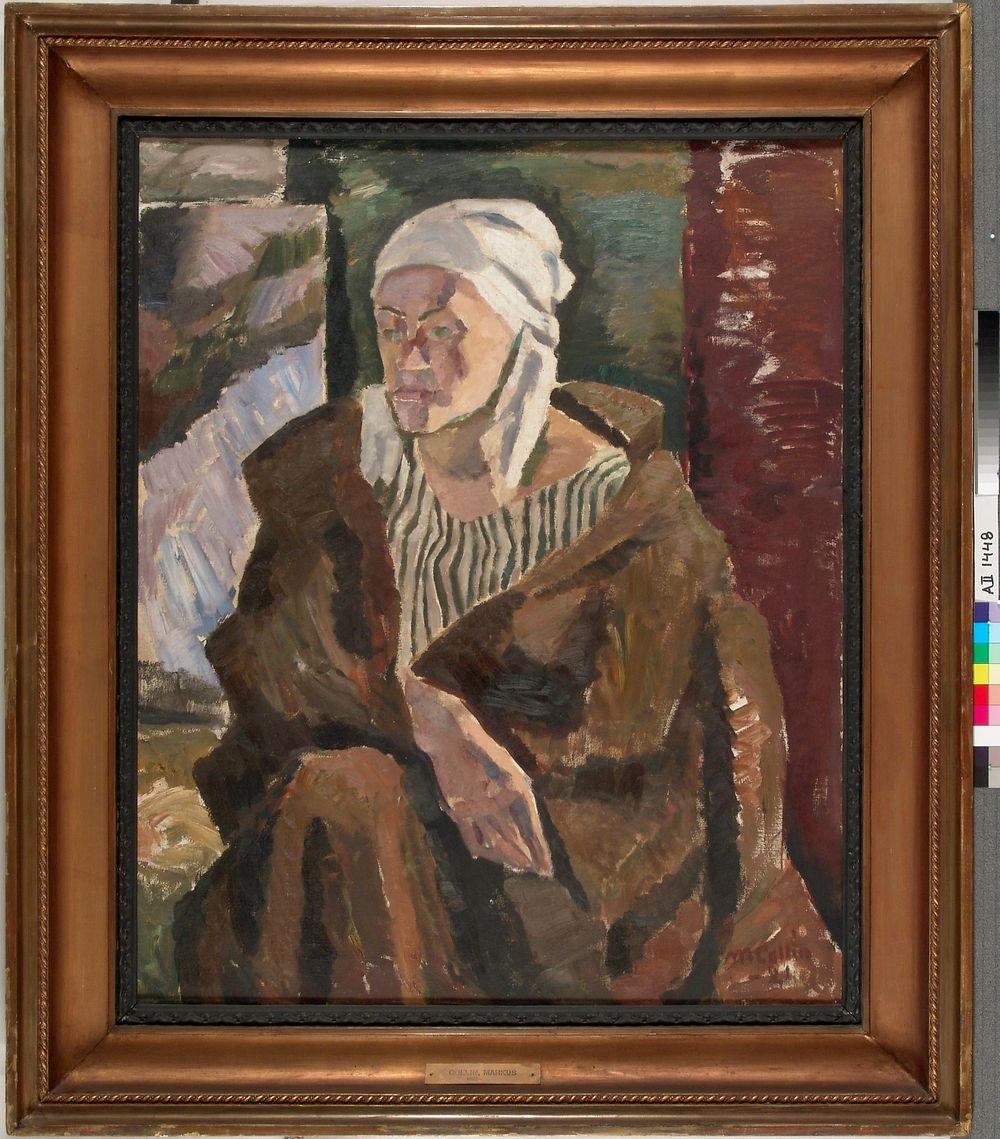 Nainen, jolla on päässään valkea huivi