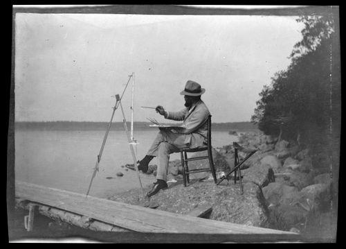 Hugo Simberg maalaa Niemenlautan Selkärannan rantakivikossa