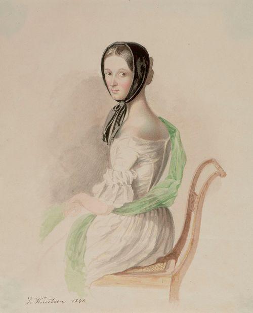 Istuva nuori nainen