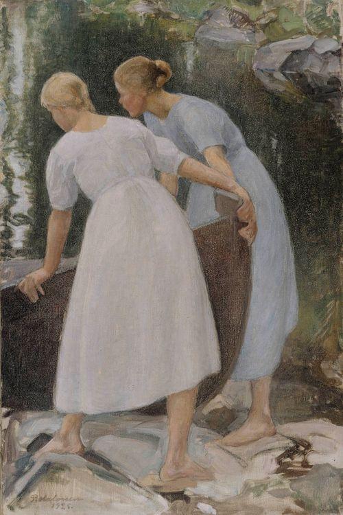 Tyttöjä työntämässä venettä vesille