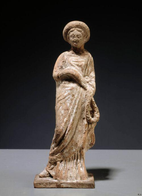 Seppelettä kantava nainen, tanagrapystykuva