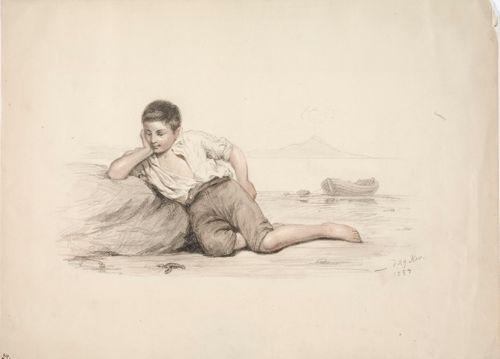 Kiveä vasten makaava italialainen poika lahden rannalla