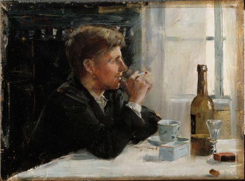 Pöydän ääressä istuva mies