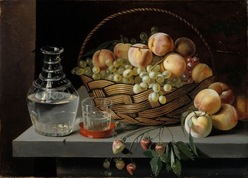 Omenoita ja viinirypäleitä korissa
