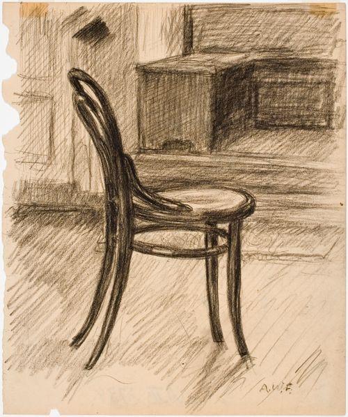 Tuoli, sivusta nähtynä, taustalla kirjoituspöytä