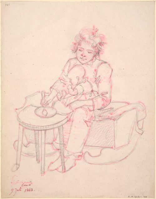 Kehdon laidalla istuva poika syöttämässä vauvaa
