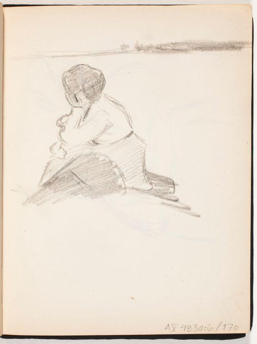 Rannalla istuva nainen