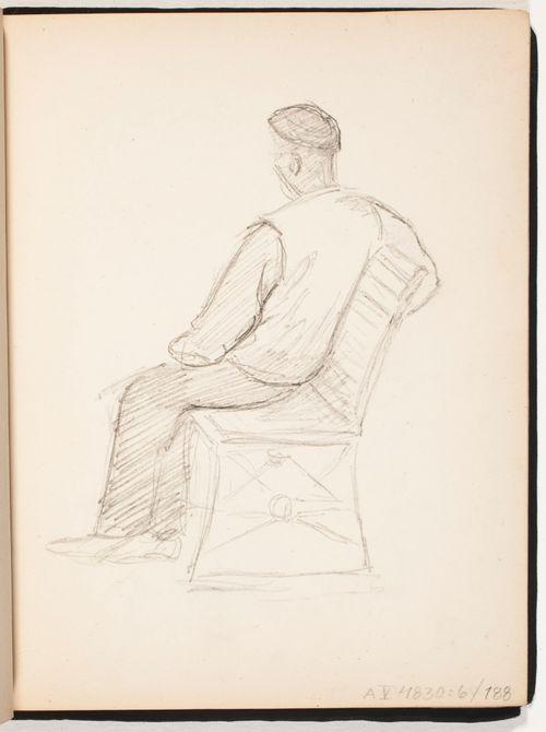Istuva mies puistonpenkillä