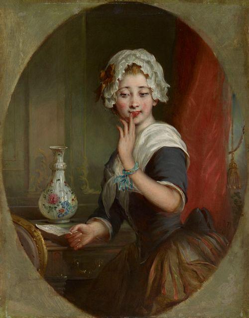 Kirjettä lukeva nuori nainen