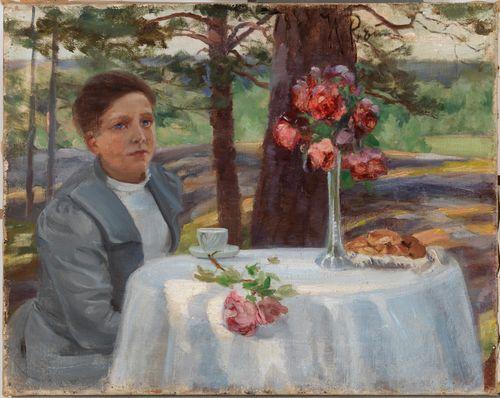 Tyttö pöydän ääressä
