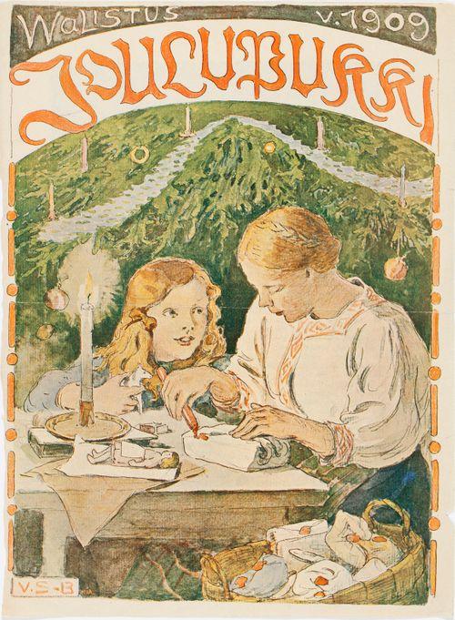 Äiti ja poika (Antti) paketoivat joululahjoja.