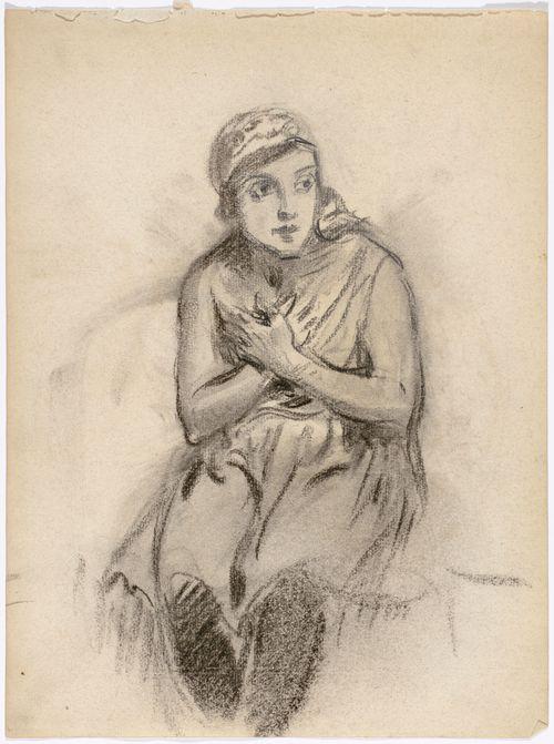 Istuva huivipäinen nainen