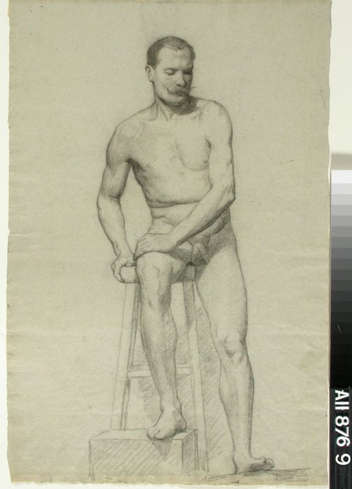 Korkealla jakkaralla istuva miesmalli