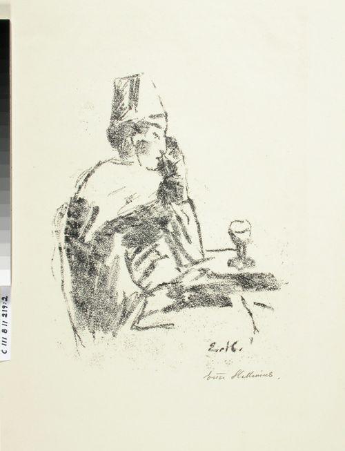 Fetsipäinen mies kahvilapöydän ääressä