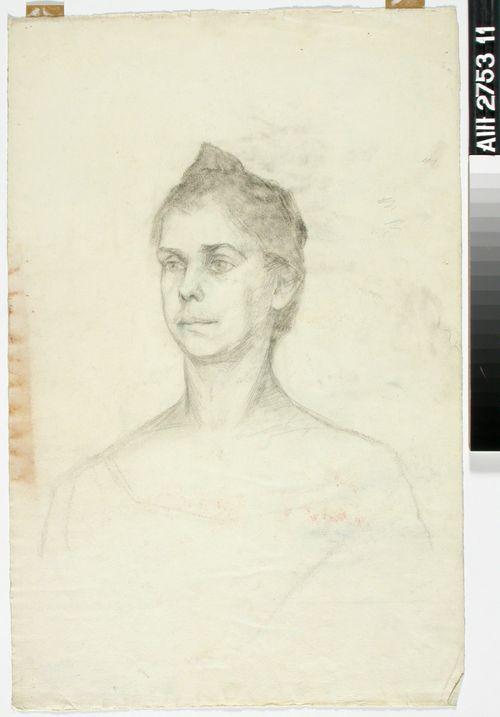 Naisen pää; keski-ikäinen nainen puolittain sivukuvassa
