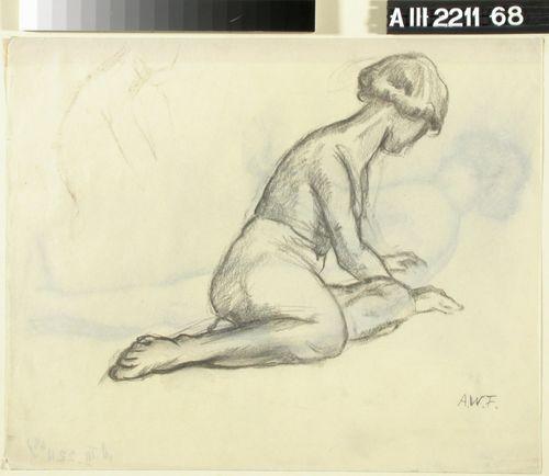 Maassa istuva tyttö