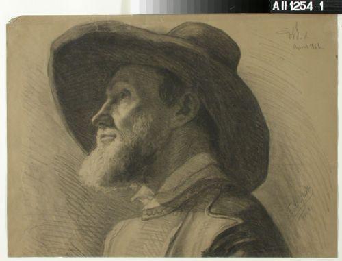 Leveäreunaiseen hattuun sonnustautunut mies